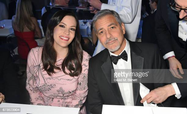 Liv Tyler and George Clooney attend the OMEGA 'Lost In Space' dinner to celebrate the 60th anniversary of the OMEGA Speedmaster which has been worn...