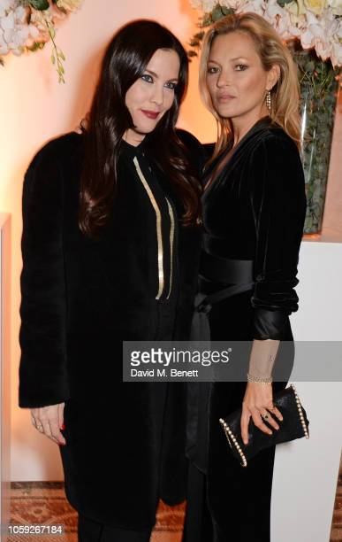 Liv Tyler and Kate Moss attend a party celebrating Edward Enninful's one year anniversary as EditorinChief of British Vogue at The National Portrait...