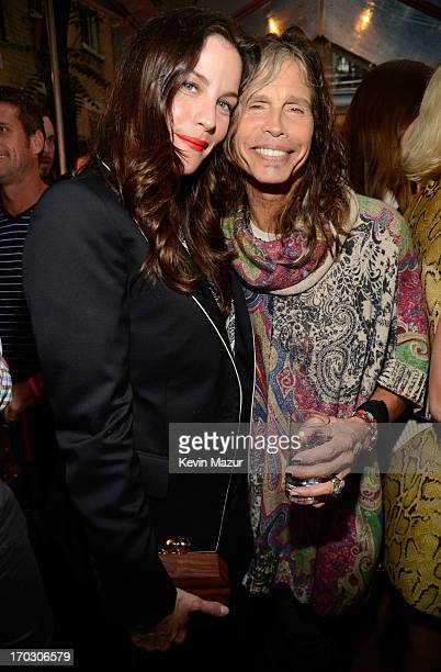 Liv Tyler and Steven Tyler attend the Stella McCartney Spring 2014 Collection Presentation at West 10th Street on June 10, 2013 in New York City.