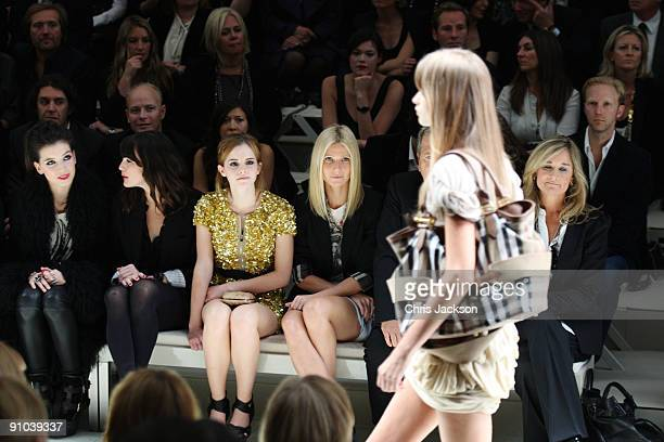 Liv Tyler Emma Watson Gwyneth Paltrow and Mario Testino watch the Burberry Prorsum Spring/Summer 2010 Show at Rootstein Hopkins Parade Ground during...