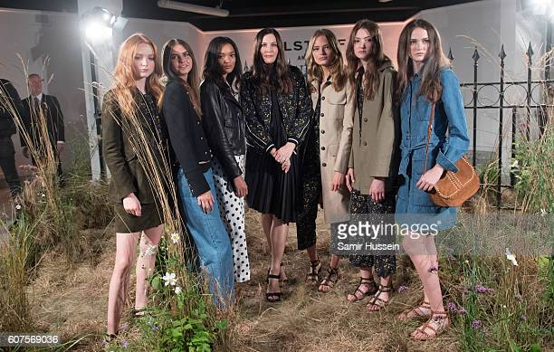 Liv Tyler poses with models at the Belstaff Presentation during London Fashion Week Spring/Summer collections 2016/2017 on September 18 2016 in...