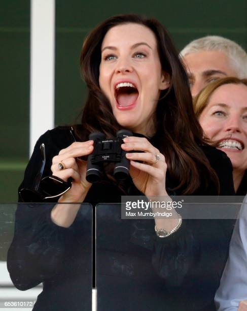 Liv Tyler watches the racing as she attends day 2 'Ladies Day' of the Cheltenham Festival at Cheltenham Racecourse on March 15 2017 in Cheltenham...