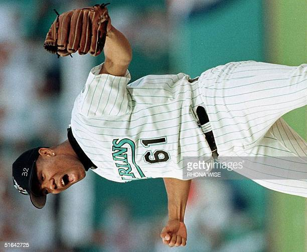 Livan Hernandez of the Florida Marlins celebrates after striking out Fred McGriff of the Atlanta Braves in the ninth inning 12 October during game...