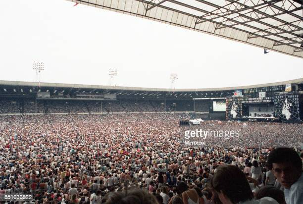 Live Aid concert held at Wembley Stadium, London to raise funds for relief of the ongoing Ethiopian famine. View of the huge crowd of around 72,000...