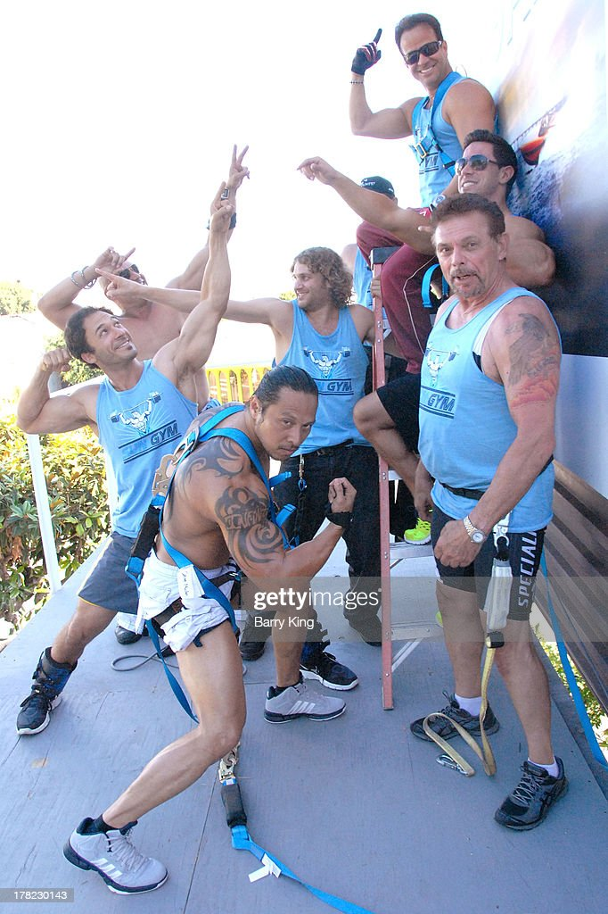 Live body builders work out on a billboard over Sunset Boulevard celebrating the Blu-Ray/DVD release of 'Pain & Gain' on August 27, 2013 in West Hollywood, California.