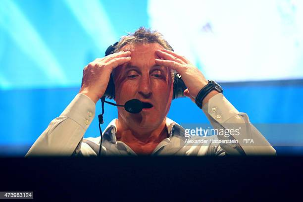 Live commentator Alan Mcinally during the finale for FIFA Interactive World Cup 2015 at Volkstheater on May 19 2015 in Munich Germany