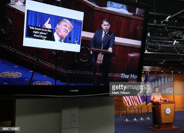 A live CSPAN feed from the House Chamber plays on a monitor as House Minority Leader Nancy Pelosi speaks to the media during her weekly news...