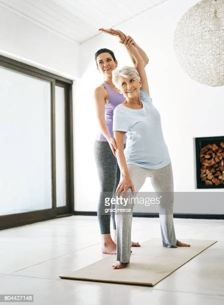 live happier and healthier with yoga - yoga teacher stock pictures, royalty-free photos & images
