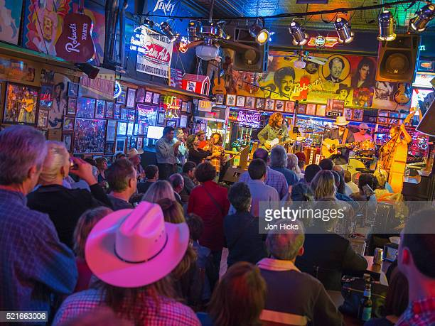 live music on nashville's broadway - nashville stock pictures, royalty-free photos & images