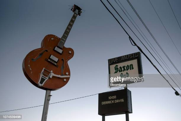 A 'Live Music' sign stands outside the Saxon Pub in Austin Texas US on Thursday Dec 20 2018 Apple Inc announced this month it's opening new offices...
