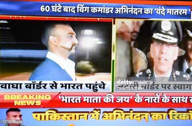 Live news channels broadcast on television images of Indian Air Force Wing Commander pilot Abhinandan Varthaman returning to India from the...