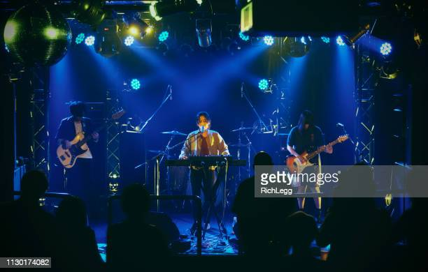 live rock band performance in tokyo japan - keyboard player stock photos and pictures