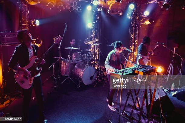 live rock band performance in tokyo japan - performance group stock pictures, royalty-free photos & images