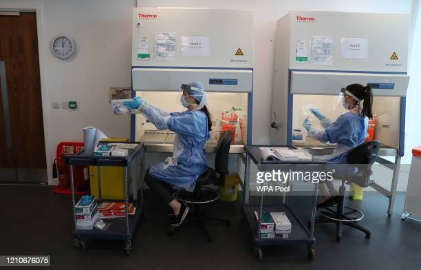 Live samples are held in a container during the opening of the new Covid-19 testing lab at Queen Elizabeth University Hospital on April 22, 2020 in...