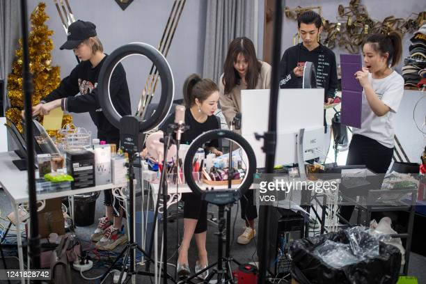 Live streamer Viya Huang Wei and her colleagues prepare for live streaming on the e-commerce platform Taobao on April 16, 2019 in Hangzhou, Zhejiang...
