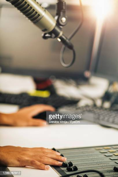 live streaming from the studio, technician adjusting control board sliders - live broadcast stock pictures, royalty-free photos & images