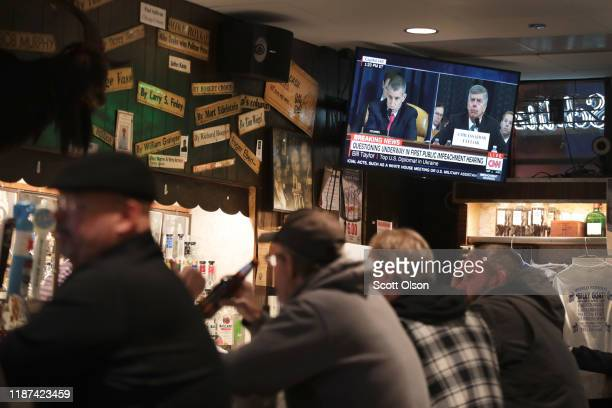 Live testimony of the House impeachment hearings against President Donald Trump is shown on a television at the Billy Goat Tavern on November 13 2019...