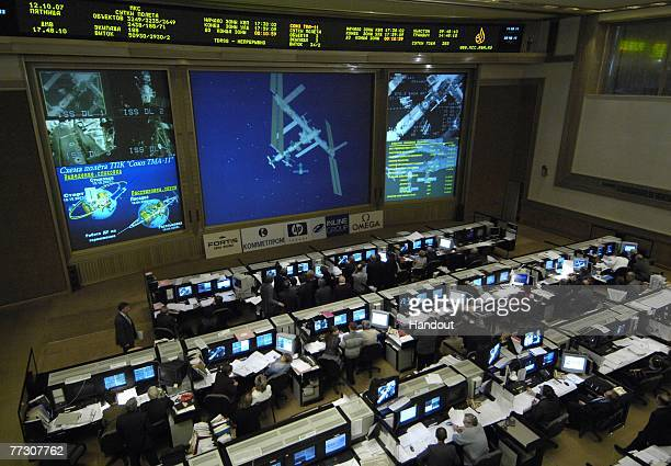 Live video from the Soyuz TMA11 spacecraft of the International Space Station is shown on the screen at the Russian Mission Control Center October 12...