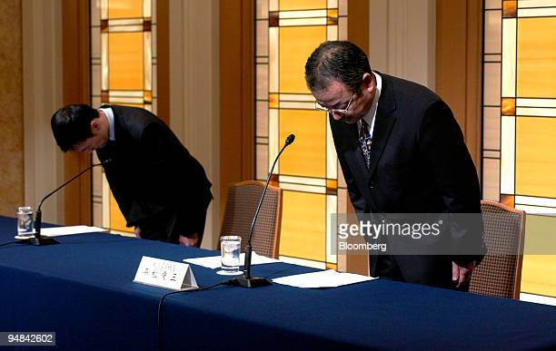 Livedoor Co Vice President Noritaka Ochiai left and President Kozo Hiramatsu right bow in apology during a press briefing in Tokyo Japan Wednesday...
