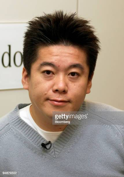 Livedoor President / CEO Takafumi Horie speaks to Bloomberg News reporters at Livedoor's headquarters in Tokyo Thursday February 24 2005 Shares of...