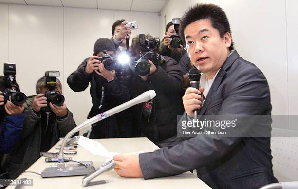 Livedoor President Takafumi Horie speaks during a press conference after being raid their headquarters on Janaury 23 2006 in Tokyo Japan