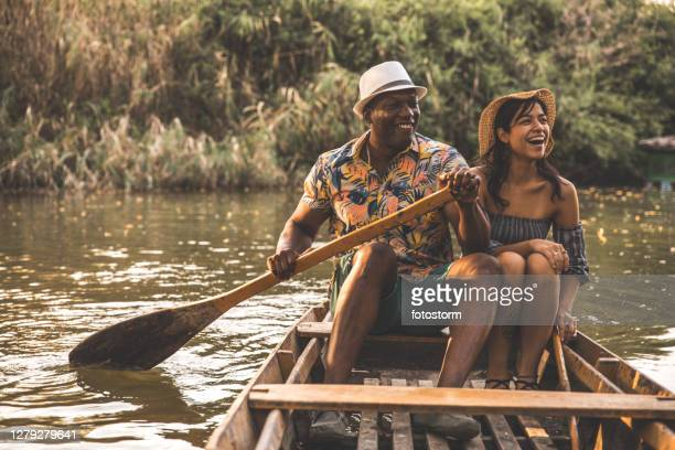 lively couple on a wooden vessel - mexican picnic stock pictures, royalty-free photos & images