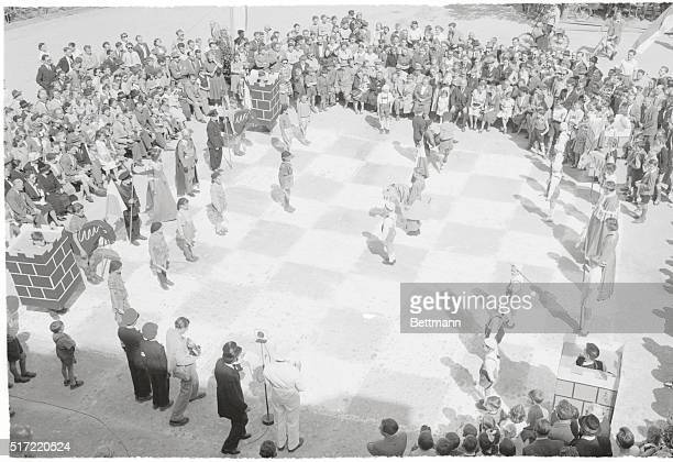 Lively Game. Ebersberg, Germany: The chessboard comes alive as residents of Ebersberg wind up a week-long chess tournament with a game, played on a...