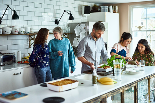 Lively relaxed three generation family gathering in kitchen - gettyimageskorea