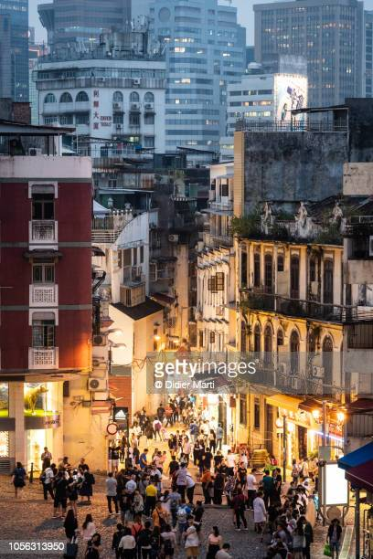 lively street in macau old town city center - macao stock pictures, royalty-free photos & images