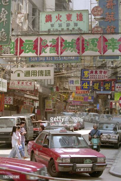 Lively traffic and shopping street in the centre of Kowloon