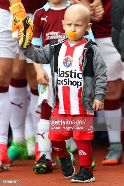 Liver Cancer patient Charlie Procter becomes the first mascot to lead out all three east Lancashire teams during the Premier League match between...