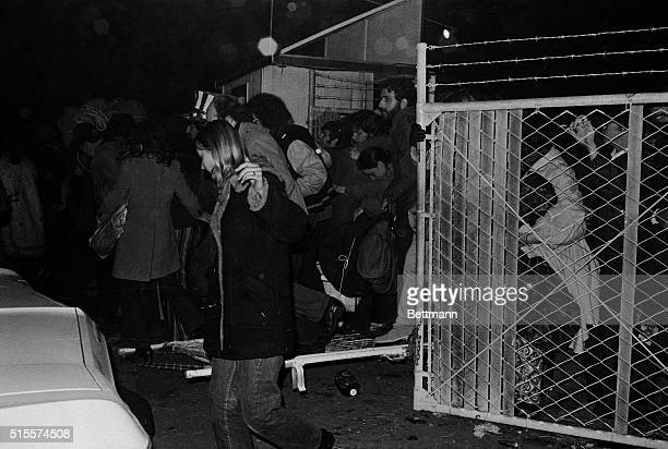 Eager rock fans storm the gate at Altamont Speedway near here well in advance of the scheduled opening for a free rock festival featuring the Rolling...