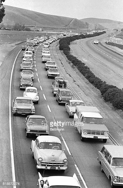 One solitary car head northwest on Highway 50 as a monumental traffic jameven by California standardsbacks up cars for nearly 20 miles as thousands...