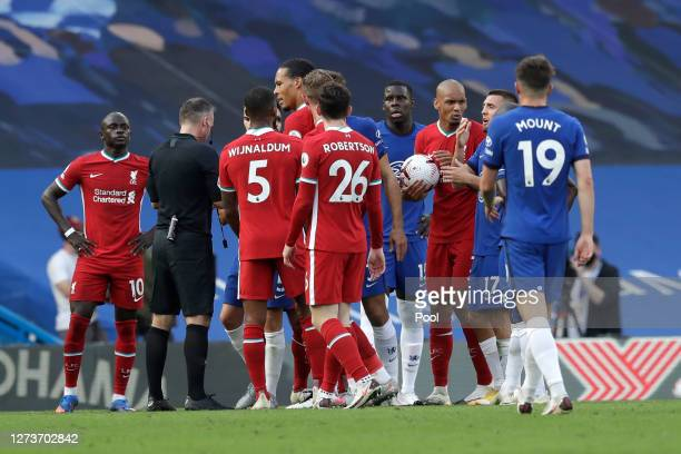 Liverpool and Chelsea players clash after a bad tackle from Andreas Christensen of Chelsea, before Andreas Christensen is eventually sent off during...