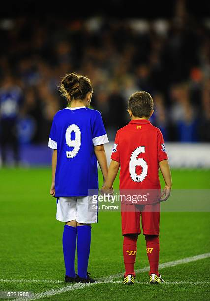 Liverpool and Everton mascots pay tribute to the Hillsbrough 96 before the Premier League match between Everton and Newcastle United at Goodison Park...