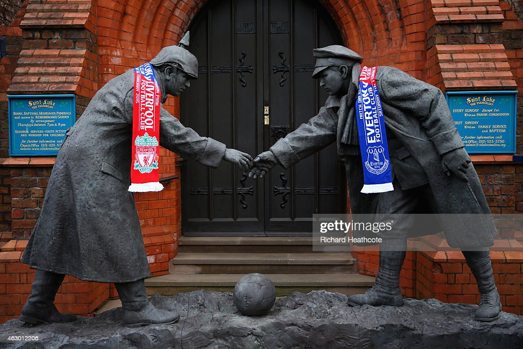 Liverpool and Everton scarves adorn a Christmas Truce statue outside a church near the stadium before the Barclays Premier League match between Everton and Liverpool at Goodison Park on February 7, 2015 in Liverpool, England.