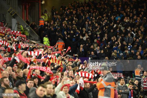 Liverpool and Everton supporters await kick off in the English Premier League football match between Liverpool and Everton at Anfield in Liverpool...