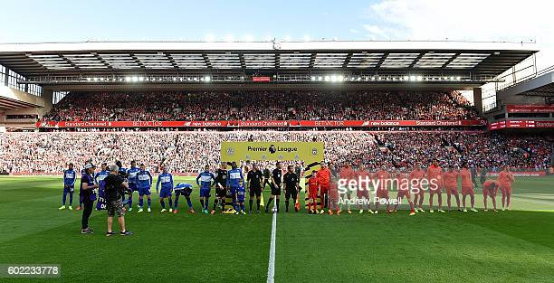 Liverpool and Leicester City line up before the Premier League match between Liverpool and Leicester City at Anfield on September 10 2016 in...