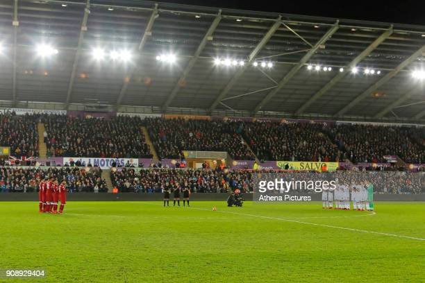 Liverpool and Swansea players applaud before kick off during the Premier League match between Swansea City and Liverpool at The Liberty Stadium on...