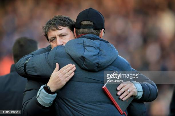 Liverpool assistant manager Peter Krawietz embraces Jurgen Klopp during the Premier League match between Liverpool FC and Brighton Hove Albion at...
