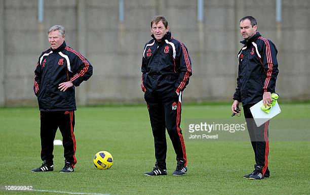Liverpool assistant manager, Sammy Lee, manager, Kenny Dalglish and head coach, Steve Clarke during a Liverpool training session at Melwood Training...