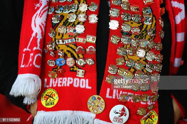 Liverpool badges are pictured on a fans scarf during The Emirates FA Cup Fourth Round match between Liverpool and West Bromwich Albion at Anfield on...