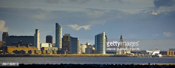Liverpool By Cityscape Against Sky