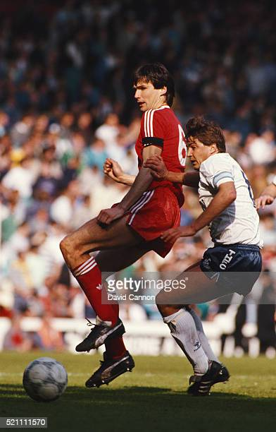 Liverpool captain Alan Hansen is challenged by Spurs captain Gary Mabbutt during a First Division match between Liverpool and Tottenham Hotspur at...