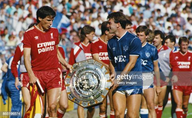 Liverpool captain Alan Hansen shares a joke with Everton captain Kevin Ratcliffe after the teams had shared the 1986 FA Charity shield after a 11...