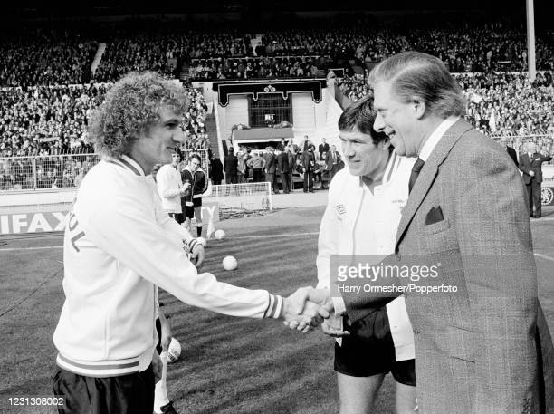 Liverpool captain Emlyn Hughes introduces Phil Thompson to the guest of honour the Earl of Harewood before the League Cup Final between Nottingham...