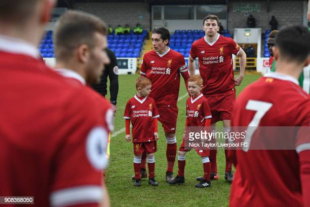 Liverpool captain Harry Wilson and Conor Masterson line up as the remainder of their team join them at the start of the Liverpool U23 v Charlton...