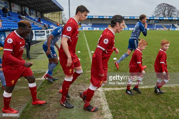 Liverpool captain Harry Wilson leads his team to the pich at the start of the Liverpool U23 v Charlton Athletic U23 Premier League Cup game at The...