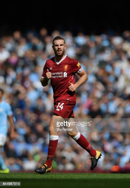 Liverpool captain Jordan Henderson in action during the Premier League match between Manchester City and Liverpool at Etihad Stadium on September 9...