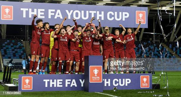Liverpool captain Paul Glatzel holds aloft the trophy along with teammates after victory in the FA Youth Cup Final at Manchester City Football...